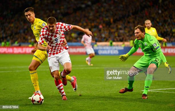 Andrej Kramaric of Croatia tangles with Yevhen Khacheridi of Ukraine as Andriy Pyatov of Ukraine looks on during the FIFA 2018 World Cup Group I...
