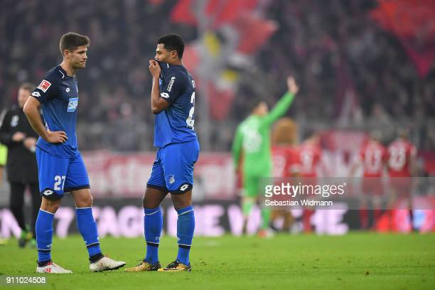Andrej Kramaric of Hoffenheim and Serge Gnabry of Hoffenheim stand on the pitch dejected after the Bundesliga match between FC Bayern Muenchen and...