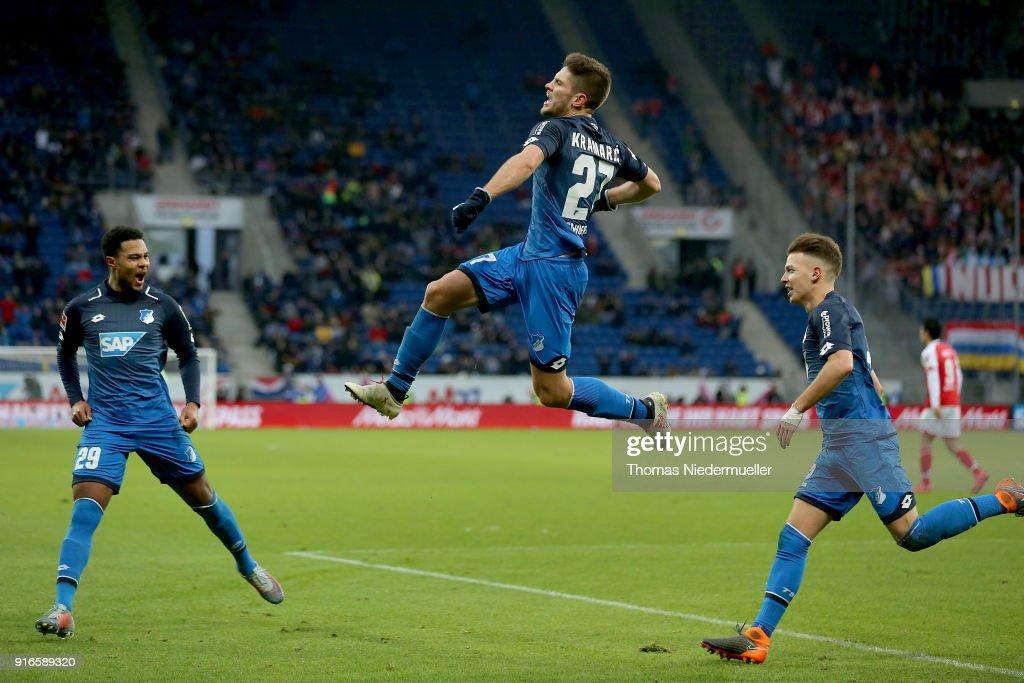 Andrej Kramaric (C) of Hoffenheim celebrates his goal during the Bundesliga match between TSG 1899 Hoffenheim and 1. FSV Mainz 05 at Wirsol Rhein-Neckar-Arena on February 10, 2018 in Sinsheim, Germany.