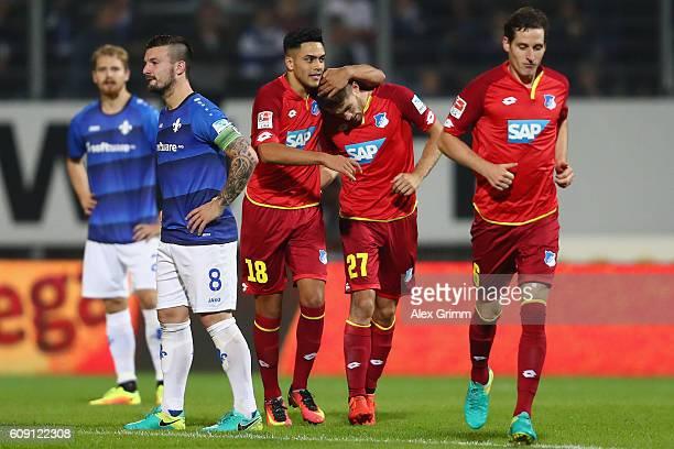 Andrej Kramaric of Hoffenheim celebrates his team's first goal with team mates Nadiem Amiri and Sebastian Rudy during the Bundesliga match between SV...