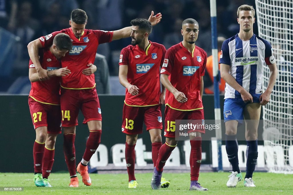 Andrej Kramaric (L) of Hoffenheim celebrates his team's third goal with team mates Sandro Wagner, Kerem Demirbay and Jeremy Toljan as Sebastian Langkamp of Berlin reactsduring the Bundesliga match between Hertha BSC and TSG 1899 Hoffenheim at Olympiastadion on March 31, 2017 in Berlin, Germany.