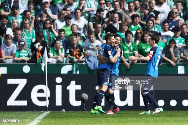 Andrej Kramaric of Hoffenheim celebrates scoring the opening goal with his team mates during the Bundesliga match between Werder Bremen and TSG 1899...