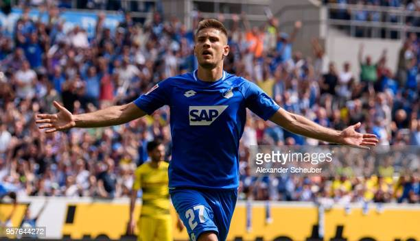 Andrej Kramaric of Hoffenheim celebrates the first goal for his team during the Bundesliga match between TSG 1899 Hoffenheim and Borussia Dortmund at...