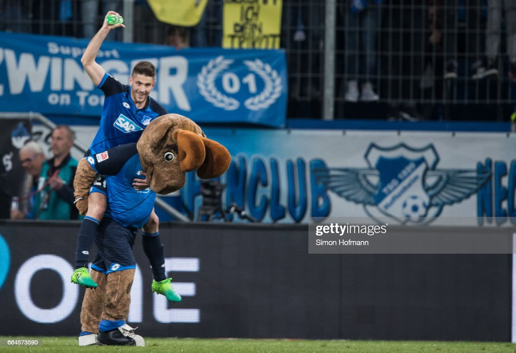 Andrej Kramaric of Hoffenheim celebrates winning with mascot Hoffi after the Bundesliga match between TSG 1899 Hoffenheim and Bayern Muenchen at Wirsol Rhein-Neckar-Arena on April 4, 2017 in Sinsheim, Germany.