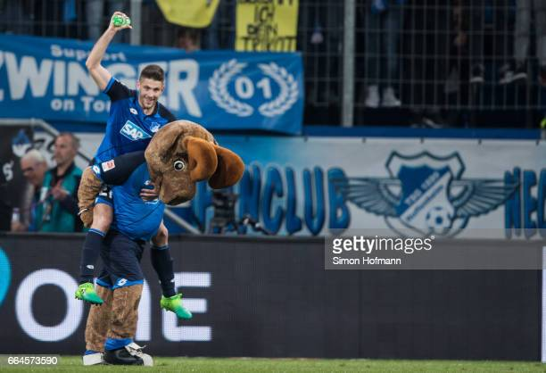 Andrej Kramaric of Hoffenheim celebrates winning with mascot Hoffi after the Bundesliga match between TSG 1899 Hoffenheim and Bayern Muenchen at...