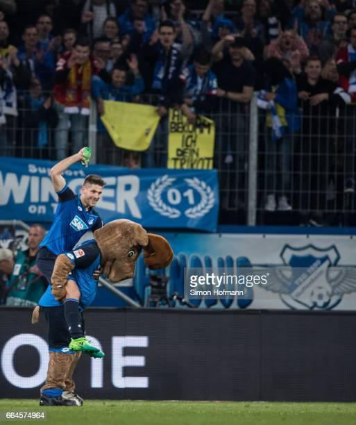 Andrej Kramaric of Hoffenheim celebrates winning with mascot Hoffi after the Bundesliga match between TSG 1899 Hoffenheim and Bayern Muenchen at...
