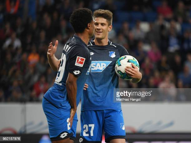 Andrej Kramaric of Hoffenheim celebrates with his injured teammate Serge Gnabry of Hoffenheim after scoring his team's first goal during the...