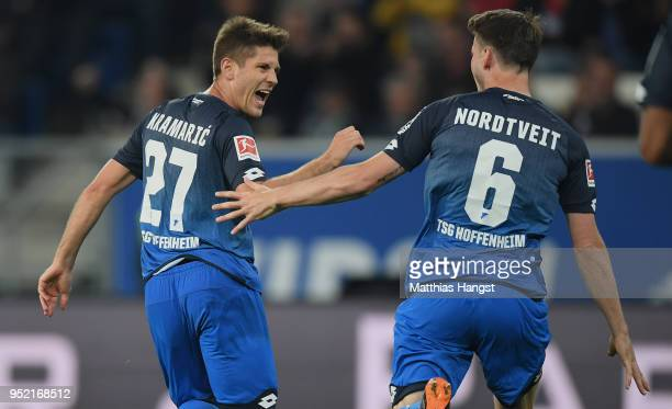 Andrej Kramaric of Hoffenheim celebrates with his teammates after scoring his team's second goal during the Bundesliga match between TSG 1899...