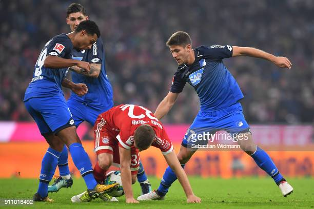 Andrej Kramaric of Hoffenheim fights for the ball with Joshua Kimmich of Bayern Muenchen and Serge Gnabry of Hoffenheim during the Bundesliga match...