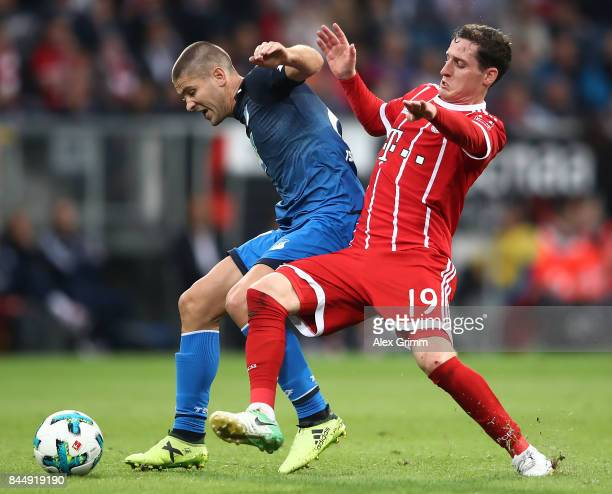 Andrej Kramaric of Hoffenheim fights for the ball with Sebastian Rudy of Bayern Muenchen during the Bundesliga match between TSG 1899 Hoffenheim and...