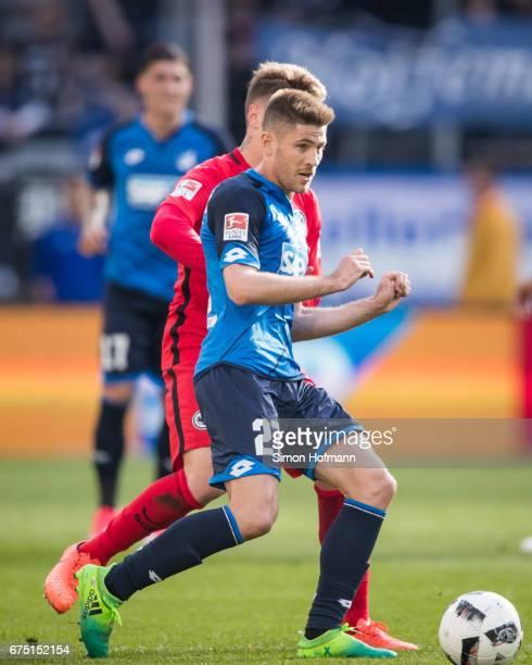 Andrej Kramaric of Hoffenheim is challenged by Guillermo Varela of Frankfurt during the Bundesliga match between TSG 1899 Hoffenheim and Eintracht...