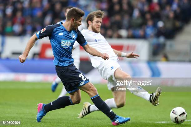 Andrej Kramaric of Hoffenheim scores his team's first goal against Peter Niemeyer of Darmstadt during the Bundesliga match between TSG 1899...