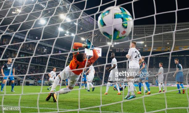 Andrej Kramaric of Hoffenheim scores his team's third goal past goalkeeper Philipp Tschauner of Hannover during the Bundesliga match between TSG 1899...