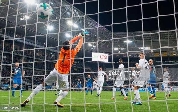 Andrej Kramaric of Hoffenheim scores his team's third goal past goalkeeper Philipp Tschauner of Hannover during the Bundesliga match between TSG 1899...