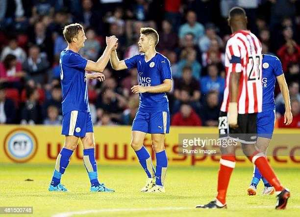 Andrej Kramaric of Leicester city celebrates with Andy king of Leicester city after scoring to make it 12 during the preseason friendly between...