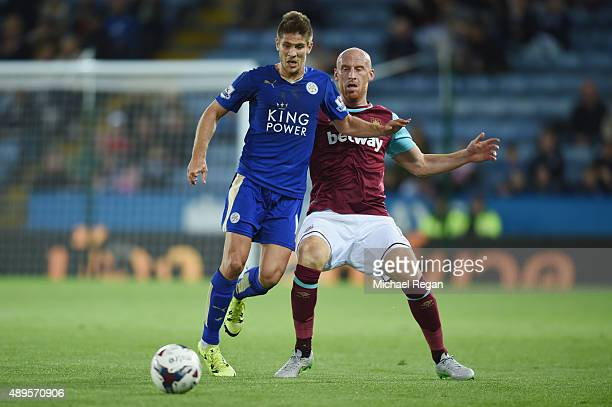 Andrej Kramaric of Leicester in action with James Collins of West Ham during the Capital One Cup Third Round match between Leicester City and West...