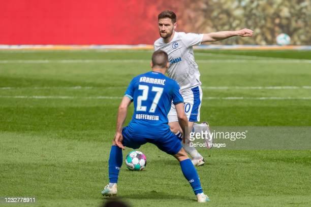 Andrej Kramaric of TSG 1899 Hoffenheim and Shkodran Mustafi of FC Schalke 04 battle for the ball during the Bundesliga match between TSG Hoffenheim...