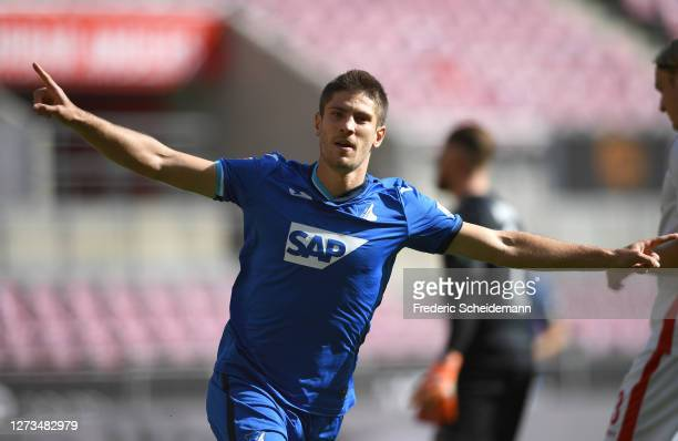 Andrej Kramaric of TSG 1899 Hoffenheim celebrates after scoring his team's first goal during the Bundesliga match between 1. FC Koeln and TSG...