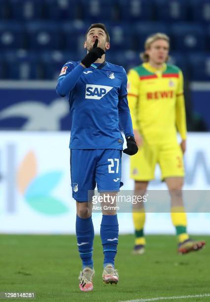 Andrej Kramaric of TSG 1899 Hoffenheim celebrates after scoring their side's first goal from the penalty spot during the Bundesliga match between TSG...