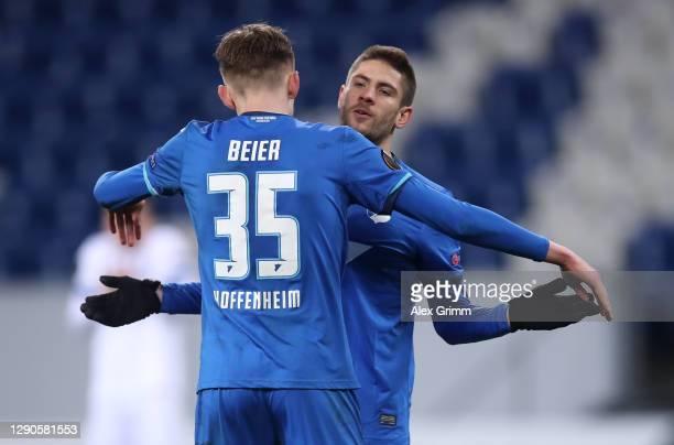 Andrej Kramaric of TSG 1899 Hoffenheim celebrates with Maximilian Beier of TSG 1899 Hoffenheim after scoring their team's fourth goal with his team...