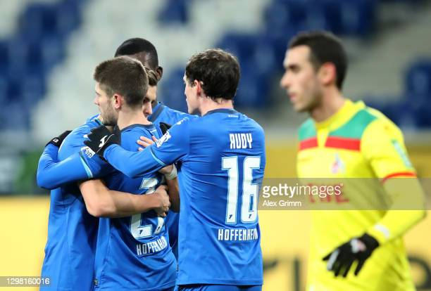 Andrej Kramaric of TSG 1899 Hoffenheim celebrates with Sebastian Rudy and team mates after scoring their side's third goal during the Bundesliga...