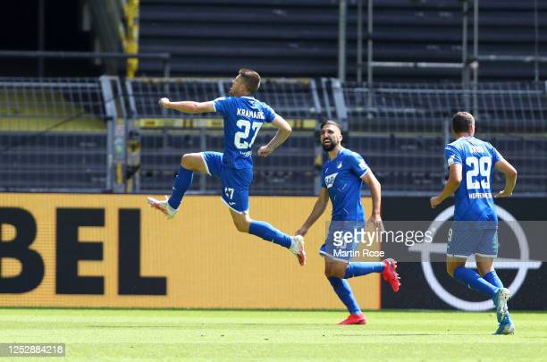 Andrej Kramaric of TSG 1899 Hoffenheim celebrates with teammates after scoring his team's first goal during the Bundesliga match between Borussia...
