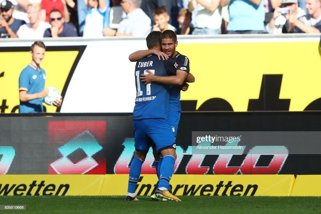 Andrej Kramaric of TSG 1899 Hoffenheim is celebrated by Steven Zuber of TSG 1899 Hoffenheim (front) after he scored to make it 1:0 during the Bundesliga match between TSG 1899 Hoffenheim and SV Werder Bremen at Wirsol Rhein-Neckar-Arena on August 19, 2017 in Sinsheim, Germany.