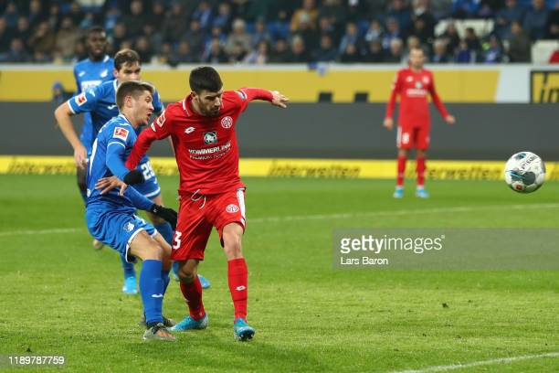 Andrej Kramaric of TSG 1899 Hoffenheim scores his team's first goal past Aaron Martin of 1. FSV Mainz 05 during the Bundesliga match between TSG 1899...