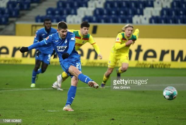 Andrej Kramaric of TSG 1899 Hoffenheim scores their side's third goal from the penalty spot during the Bundesliga match between TSG Hoffenheim and 1....