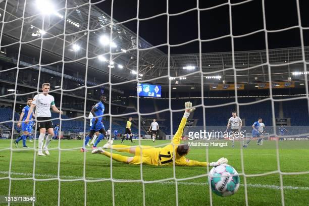 Andrej Kramaric of TSG 1899 Hoffenheim scores their side's third goal past Tobias Sippel of Borussia Moenchengladbach during the Bundesliga match...