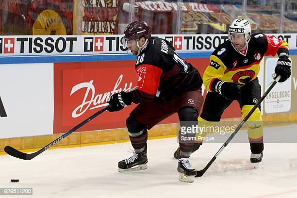 Andrej Kudrna of HC Sparta Prague challenges Justin Krueger of Bern during the Champions Hockey League Quarter Final match between Sparta Prague and...