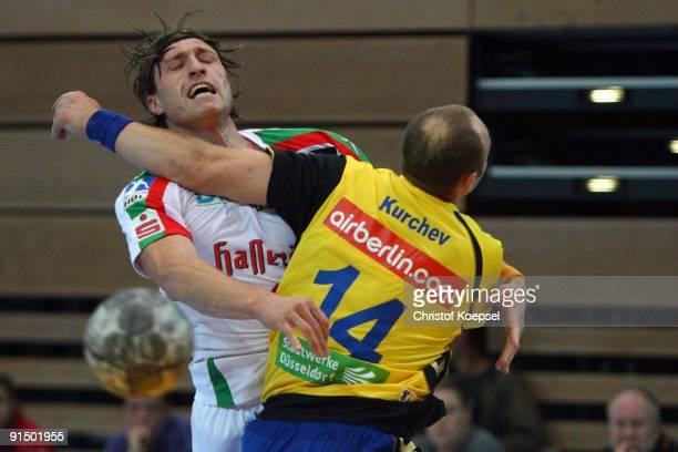 Andrej Kurchev of Duesseldorf tackles Fabian van Olphen of Magdeburg during the Toyota Handball Bundesliga match between HSG Duesseldorf and SC...