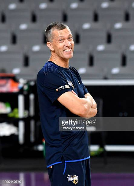 Andrej Lemanis has a laugh with his players during a Brisbane Bullets NBL training session at the Nissan Arena on December 10, 2020 in Brisbane,...