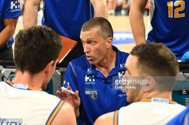 Andrej Lemanis the coach of the Bullets speaks to his players during the round six NBL match between Melbourne United and the Brisbane Bullets at...