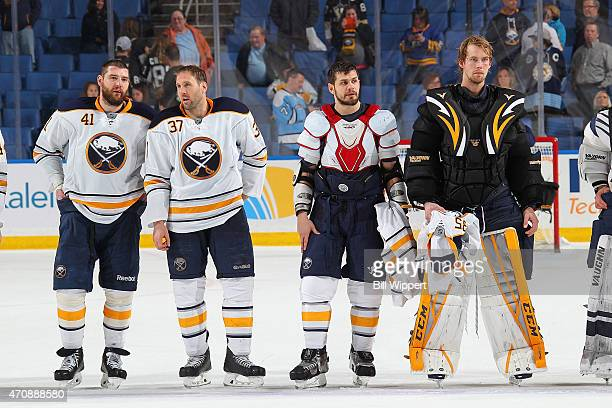 Andrej Meszaros Matt Ellis Patrick Kaleta and Anders Lindback of the Buffalo Sabres wait to hand their jerseys to fans after their game against the...