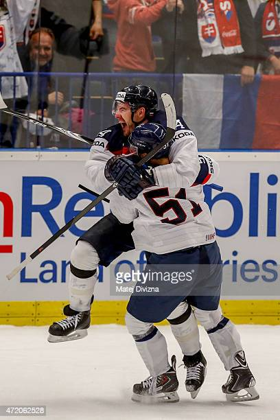 Andrej Meszaros of Slovakia celebrates a goal with his teammate Dominik Granak during the IIHF World Championship group B match between Belarus and...