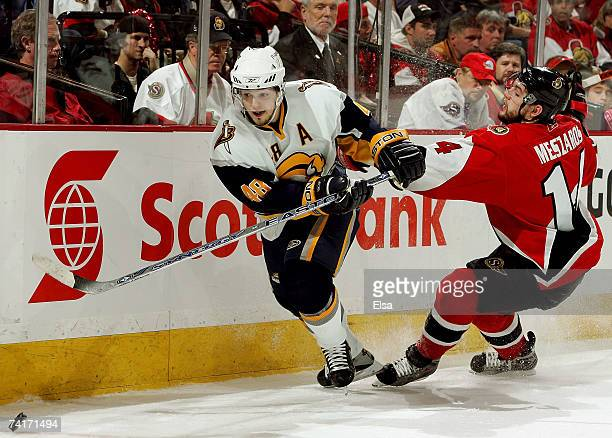 Andrej Meszaros of the Ottawa Senators tries to slow down Daniel Briere of the Buffalo Sabres during the third period of Game 4 of the 2007 Eastern...