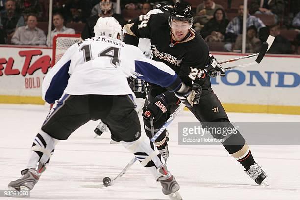 Andrej Meszaros of the Tampa Bay Lighting defends against Evgeny Artyukhin of the Anaheim Ducks during the game on November 19 2009 at Honda Center...