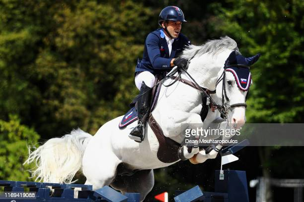 Andrej Pavlovic of Slovenia riding Arezzo Z competes during Day 3 of the Longines FEI Jumping European Championship speed competition against the...