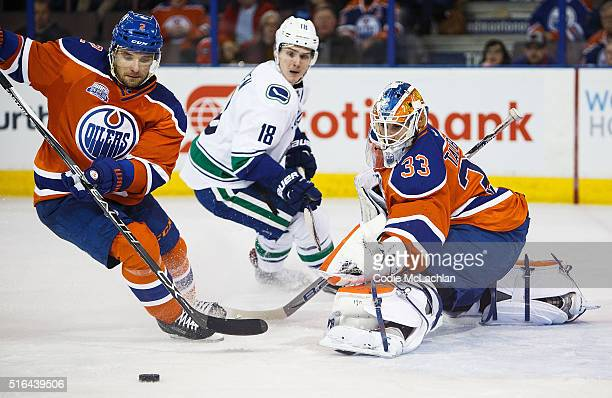 Andrej Sekera and goaltender Cam Talbot of the Edmonton Oilers defend the net against Jake Virtanen of the Vancouver Canucks on March 18 2016 at...