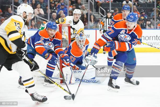 Andrej Sekera and Oscar Klefbom of the Edmonton Oilers defend against Nick Bonino of the Pittsburgh Penguins on March 10 2017 at Rogers Place in...