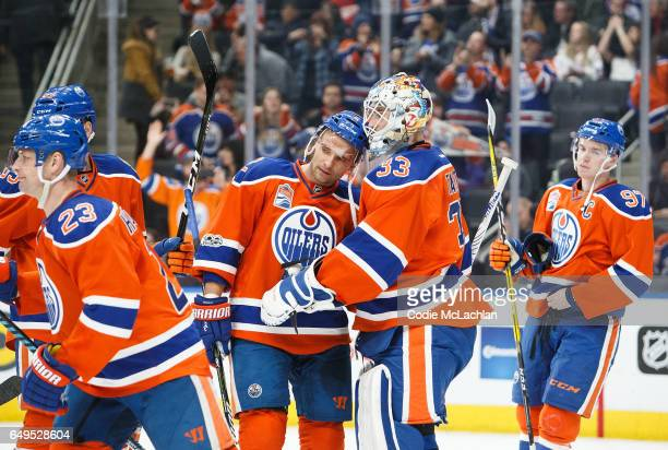 Andrej Sekera congratulates goalie Cam Talbot of the Edmonton Oilers on the win against the Detroit Red Wings on March 4 2017 at Rogers Place in...