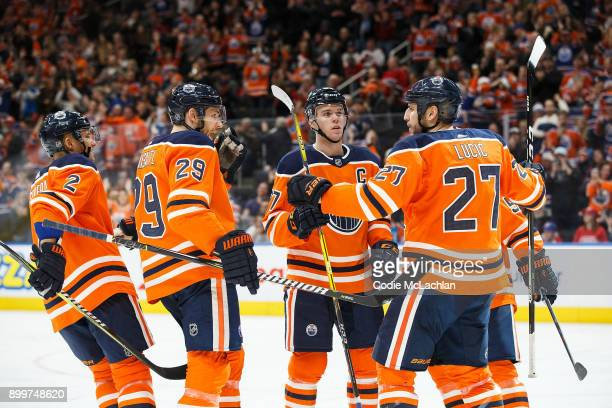 Andrej Sekera Leon Draisaitl Connor McDavid and Milan Lucic of the Edmonton Oilers celebrate Lucic's goal against the Montreal Canadiens at Rogers...