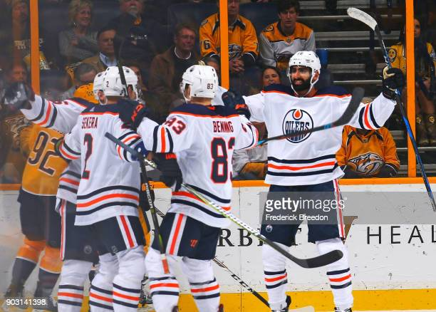 Andrej Sekera Matthew Benning and Jujhar Khaira of the Edmonton Oilers celebrate a goal against the Nashville Predators during the third period at...