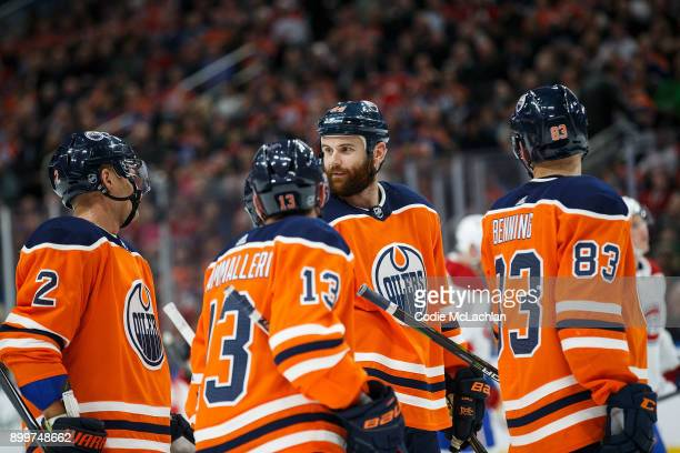 Andrej Sekera Mike Cammalleri Zack Kassian and Matthew Benning of the Edmonton Oilers strategize against the Montreal Canadiens at Rogers Place on...