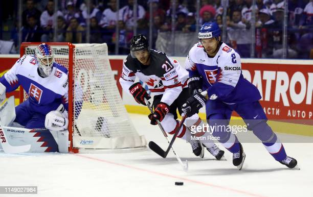 Andrej Sekera of Slovakia challenges Mathieu Joseph of Canada during the 2019 IIHF Ice Hockey World Championship Slovakia group A game between...