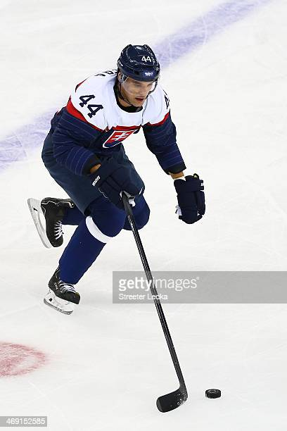 Andrej Sekera of Slovakia controls the puck against the United States during the Men's Ice Hockey Preliminary Round Group A game on day six of the...