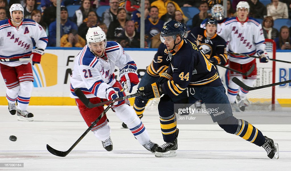 Andrej Sekera #44 of the Buffalo Sabres battles for the puck with Derek Stepan #21 of the New York Rangers at First Niagara Center on April 19, 2013 in Buffalo, New York.