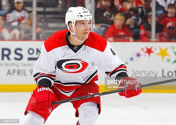 Andrej Sekera of the Carolina Hurricanes in action against the New Jersey Devils at the Prudential Center on March 8 2014 in Newark New Jersey The...
