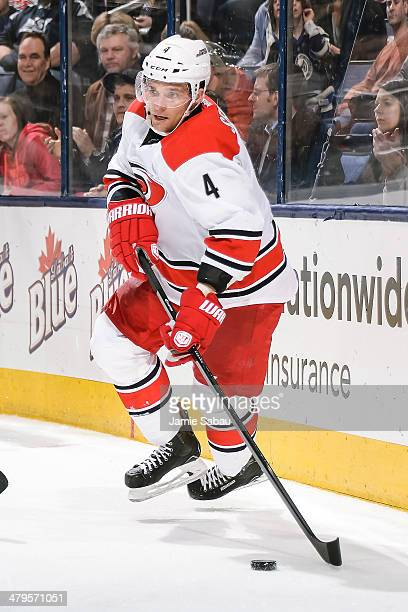Andrej Sekera of the Carolina Hurricanes skates with the puck against the Columbus Blue Jackets on March 18 2014 at Nationwide Arena in Columbus Ohio...